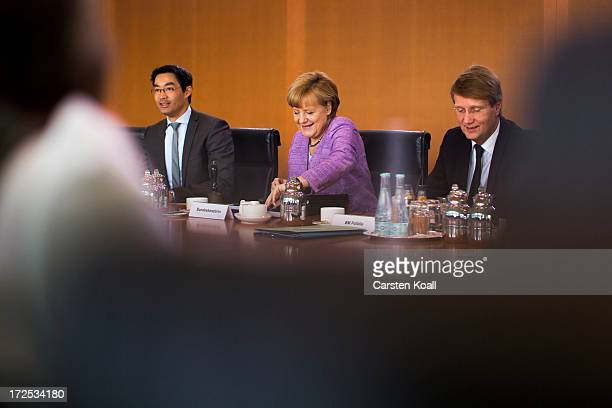 Philip Roesler German Minister for Economics German Chancellor Angela Merkel and Minister of the Chancellery Ronald Pofalla attend the weekly cabinet...