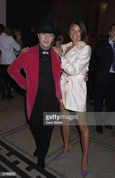 Philip Salon and Karron Eubank wife of boxer Chris attends the launch of the Versace Retrospective Exhibition held at The Victoria and Albert Museum...