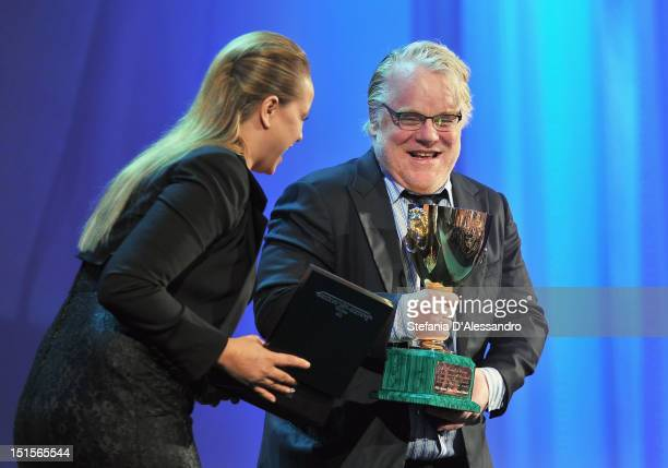 Philip Seymour Hoffman receieves the Coppa Volpi award for best actor from jury member Samantha Morton during the Award Ceremony during The 69th...