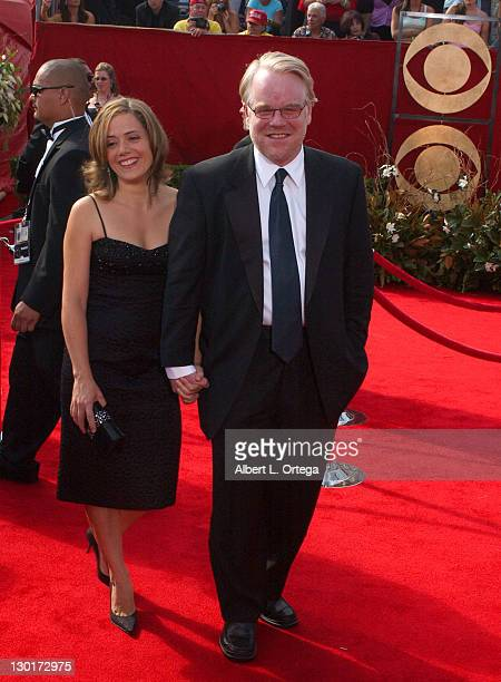 Philip Seymour Hoffman with guest during The 57th Annual Emmy Awards Arrivals at Shrine Auditorium in Los Angeles California United States