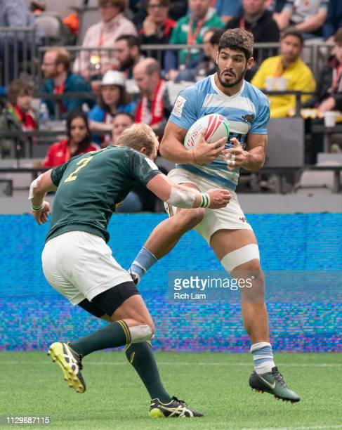 Philip Snyman of South Africa tackles German Schulz of Argentina during rugby sevens action on Day 2 of the HSBC Canada Sevens at BC Place on March...