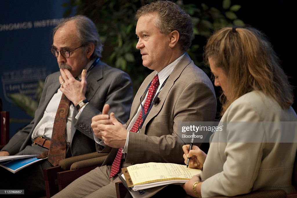 Philip Suttle, director of economics for The Institute of International Finance, center, speaks while William Janeway, senior advisor for Warburg Pincus LLC, left, and Lori Wallach, president of Global Trade Watch, right, listen at the Levy Economics Institute conference in New York, U.S., on Thursday, April 14, 2011. The 20th Annual Levy Economics Conference, which runs from April 13-15, will address the ongoing effects of the global financial crisis on the real economy as well as examine proposed and recently enacted policy responses. Photographer: Michael Nagle/Bloomberg via Getty Images