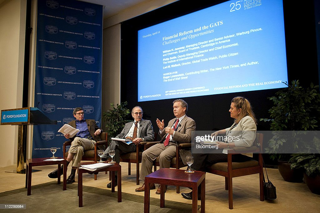 Philip Suttle, director of economics for The Institute of International Finance, second right, speaks while Roger Lowenstein, contributing writer for The New York Times, left, William Janeway, senior advisor for Warburg Pincus LLC, second left, and Lori Wallach, president of Global Trade Watch, right, listen at the Levy Economics Institute conference in New York, U.S., on Thursday, April 14, 2011. The 20th Annual Levy Economics Conference, which runs from April 13-15, will address the ongoing effects of the global financial crisis on the real economy as well as examine proposed and recently enacted policy responses. Photographer: Michael Nagle/Bloomberg via Getty Images