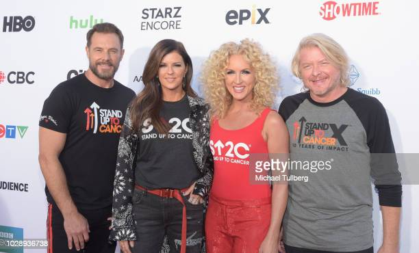 Philip Sweet Jimi Westbrook Karen Fairchild Kimberly Schlapman and Jimi Westbrook of Little Big Town arrive at the Stand Up To Cancer Marks 10 Years...
