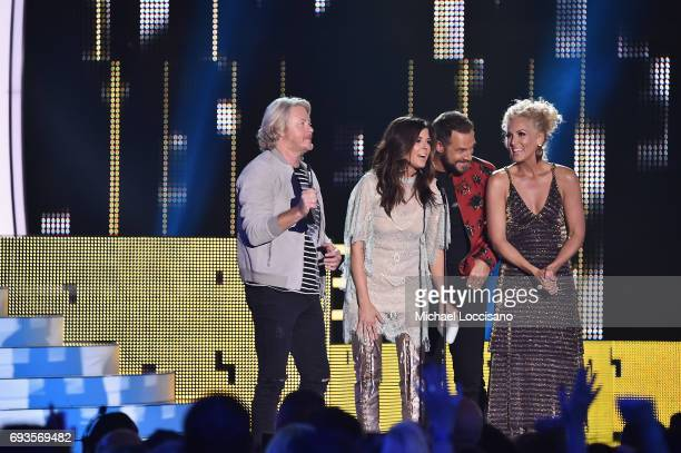 Philip Sweet Karen Fairchild Jimi Westbrook and Kimberly Schlapman of Little Big Town accept award onstage during the 2017 CMT Music Awards at the...