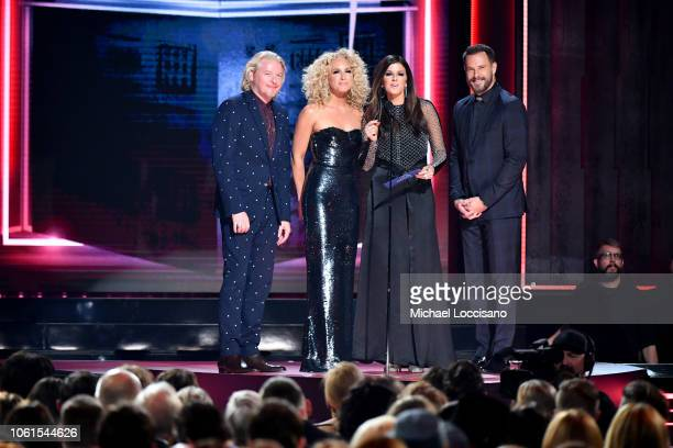 Philip Sweet Kimberly Schlapman Karen Fairchild and Jimi Westbrook of Little Big Town speak onstage during the 52nd annual CMA Awards at the...