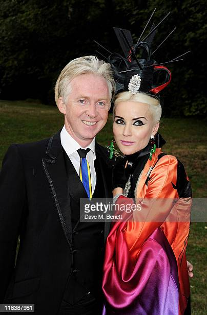 Philip Treacy and Daphne Guinness arrive at The White Fairy Tale Love Ball hosted by Valentino Garavani and Natalia Vodianova in aid of the Naked...