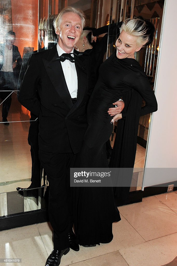 Philip Treacy (L) and Daphne Guinness attend the Isabella Blow: Fashion Galore! charity dinner hosted by the Isabella Blow Foundation at Claridges Hotel on November 19, 2013 in London, England.