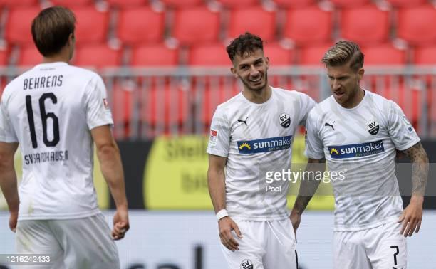 Philip Tuerpitz of Sandhausen celebrates with team mates after scoring his sides third goal during the Second Bundesliga match between SV Sandhausen...