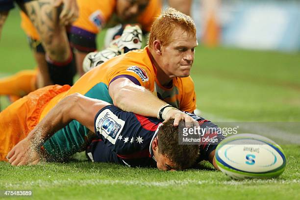 Philip van der Walt of the Cheeters stops Tom English of the Rebels from making a try during the round three Super Rugby match between the Melbourne...