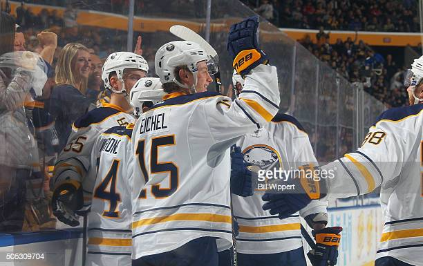 Philip Varone of the Buffalo Sabres celebrates his first period goal against the Washington Capitals with teammate Jack Eichel during an NHL game on...
