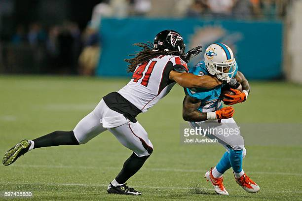 Philip Wheeler of the Atlanta Falcons tackles Isaiah Pead of the Miami Dolphins during a preseason game on August 25 2016 at Camping World Stadium in...