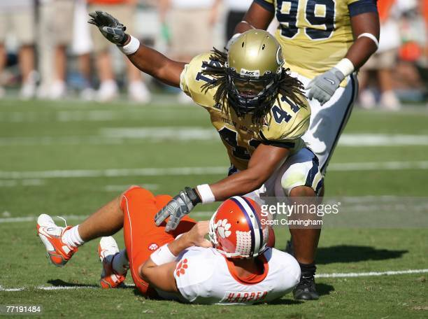 Philip Wheeler of the Georgia Tech Yellow Jackets finishes a tackle against the Clemson Tigers at Bobby Dodd Stadium on September 29, 2007 in...