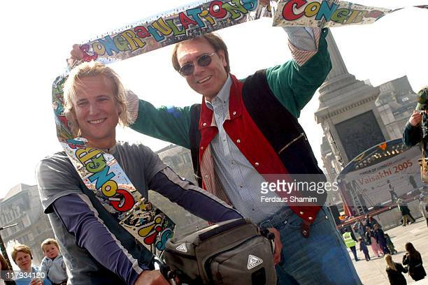 Philip White and Sir Cliff Richard during A New World Record for Cycling Photocall at Trafalgar Square in London Great Britain