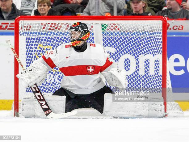 Philip Wüthrich of Switzerland defends his net against Canada during the second period of play in the Quarterfinal IIHF World Junior Championship...