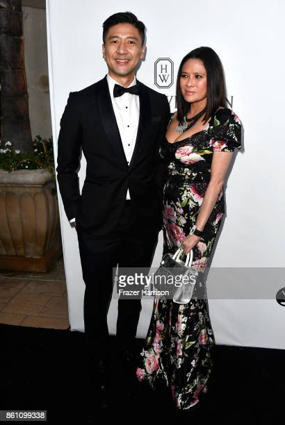 Philip Yau and Yvette Yung attend the amfAR Gala at Ron Burkle's Green Acres Estate on October 13 2017 in Beverly Hills California