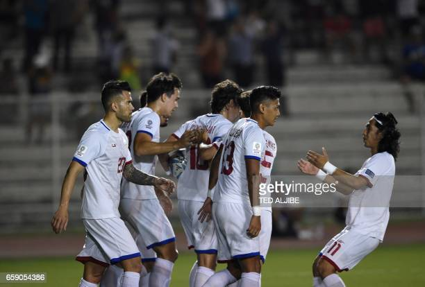 Philip Younghusband of the Philippines celebrates with teammates his first goal against Nepal during the qualifying football match between the...