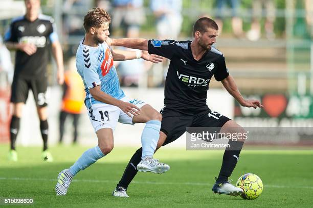 Philip Zinckernagel of SonderjyskE and Perry Kitchen of Randers FC compete for the ball during the Danish Alka Superliga match between SonderjyskE...