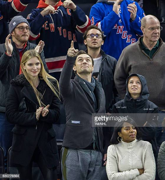 Philipa Coan, Jude Law and Iris Law are seen at Madison Square Garden on December 18, 2016 in New York City.