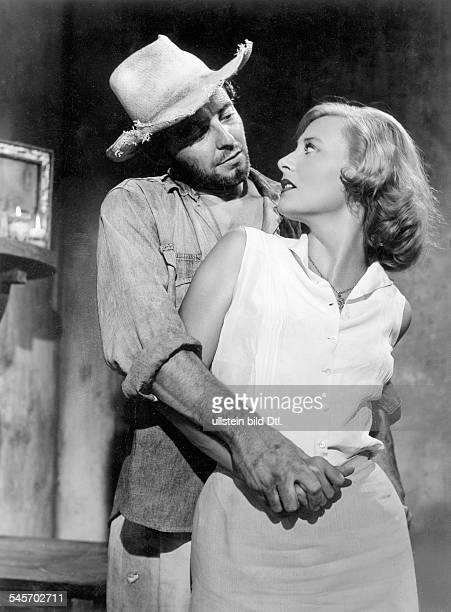 "Philipe, Gérard *-+Actor, Francewith Michelle Morgan in the movie ""Les Orgueilleux""- 1953"