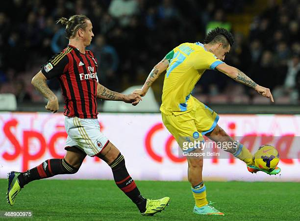 Philipe Mexes of Milan and Marek Hamsik of Napoli in action during the Serie A match between SSC Napoli and AC Milan at Stadio San Paolo on February...