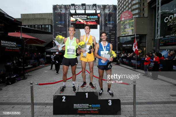 Philipe ViauDupuis of Canada Alexis LavoieGilbert of Canada and Benjamin Raymond of Canada celebrate after winning the half marathon of the Oasis...
