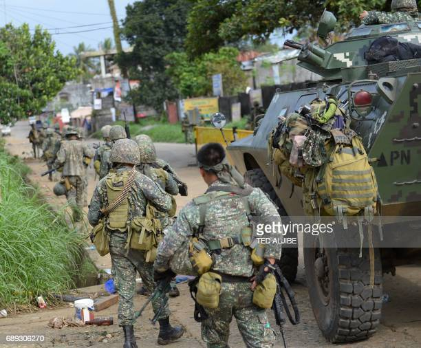 Philipine marines take their position as they begin an assault on Muslim militants' hide out near the city hall in Marawi in southern island of...