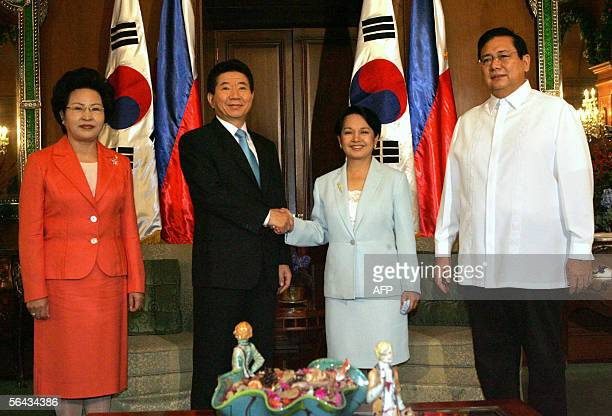 Philipine president Gloria Arroyo with first gentleman Jose Miguel Arroyo greets visiting South Korean President Roh MooHyun with his wife Kwon...