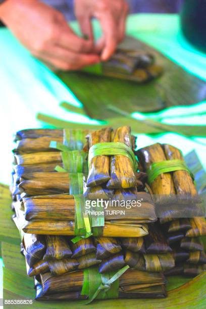 Philipins, Cebu City. Cebu Island. Suman is a rice cake originating from the Philippines. It is made from glutinous rice cooked in coconut milk, and often steamed wrapped in buli or buri palm