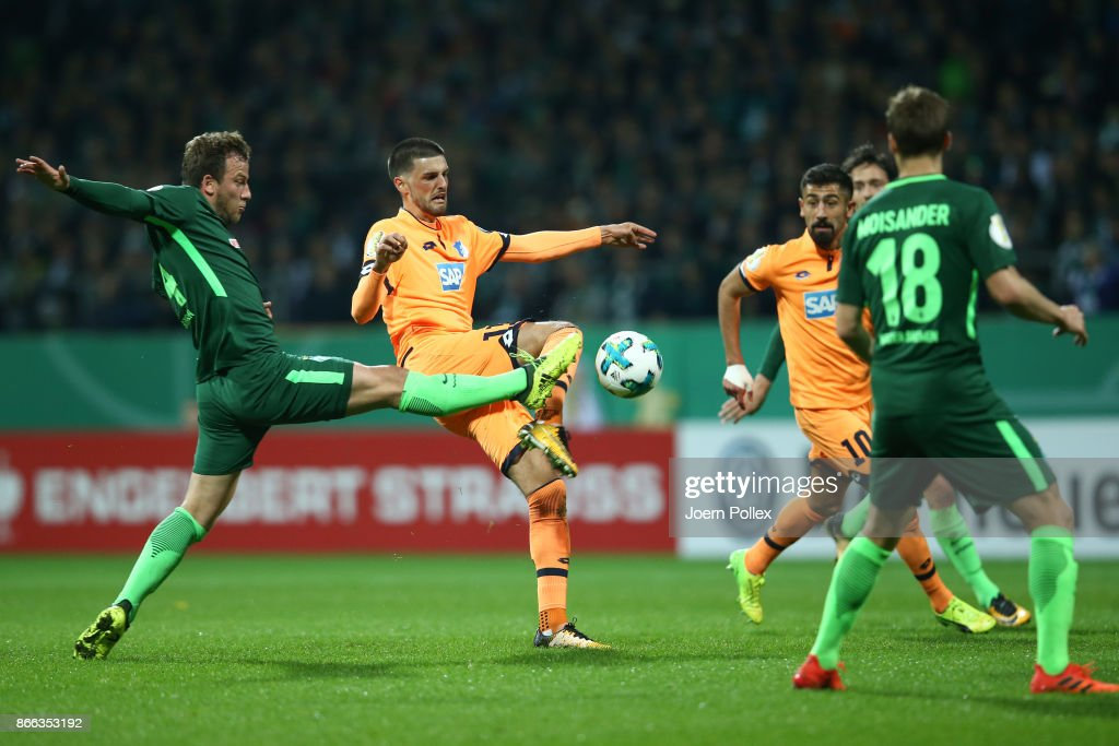Philipp Bargfrede (L) of Bremen and Florian Grillitsch of Hoffenheim compete for the ball during the DFB Cup match between Werder Bremen and 1899 Hoffenheim at Weserstadion on October 25, 2017 in Bremen, Germany.