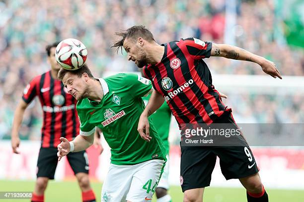 Philipp Bargfrede of Bremen and Haris Steferovic of Frankfurt compete for the ball during the First Bundesliga match between SV Werder Bremen and...