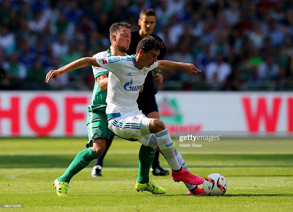 Philipp Bargfrede (L) of Bremen and Leon Goretzka of Schalke battle for the ball during the Bundesliga match between SV Werder Bremen and Schalke 04 at Weserstadion on August 15, 2015 in Bremen, Germany.