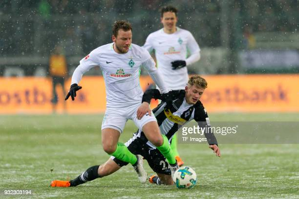 Philipp Bargfrede of Bremen and Mickael Cuisance of Moenchengladbach battle for the ball during the Bundesliga match between Borussia...