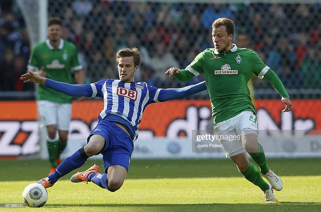Philipp Bargfrede (R) of Bremen and Sebastian Langkamp of Berlin compete for the ball during the Bundesliga match between Werder Bremen and Hertha BSC at Weserstadion on May 3, 2014 in Bremen, Germany.