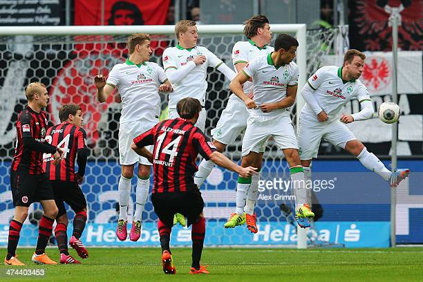 Philipp Bargfrede of Bremen and team mates try to block a freekick of Alexander Meier of Frankfurt during the Bundesliga match between Eintracht...