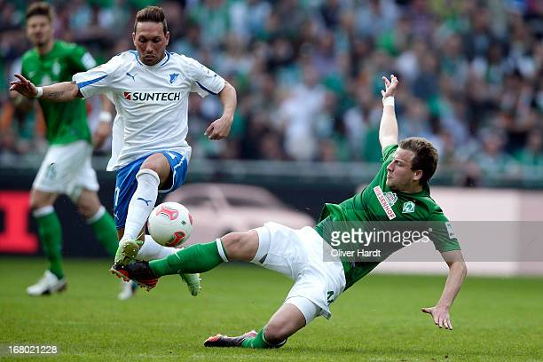 Philipp Bargfrede of Bremen and Tobias Weis of Hoffenheim battle for the ball during the Bundesliga match between SV Werder Bremen and TSG 1899...