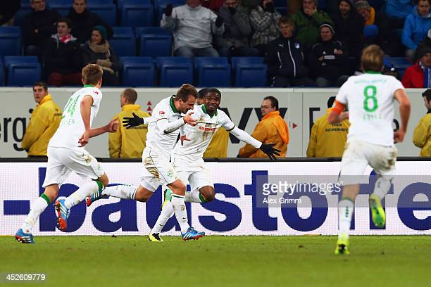Philipp Bargfrede of Bremen celebrates his team's fourth goal with team mates Nils Petersen Cedric Makiadi and Clemens Fritz during the Bundesliga...