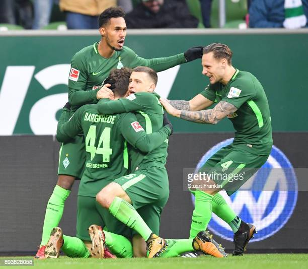 Philipp Bargfrede of Bremen celebrates scoring the first goal with teamates during the Bundesliga match between SV Werder Bremen and 1 FSV Mainz 05...