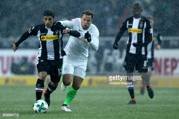 Philipp Bargfrede of Bremen challenges Lars Stindl of Moenchengladbach during the Bundesliga match between Borussia Moenchengladbach and SV Werder...