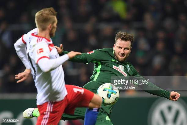 Philipp Bargfrede of Bremen fights for the ball with Aaron Hunt of Hamburg during the Bundesliga match between SV Werder Bremen and Hamburger SV at...