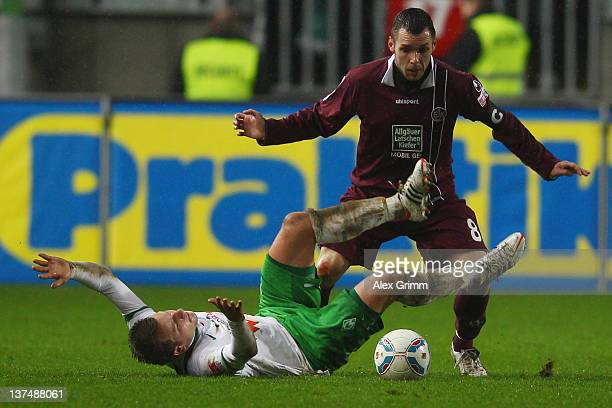 Philipp Bargfrede of Bremen is challenged by Christian Tiffert of Kaiserslautern during the Bundesliga match between 1. FC Kaiserslautern and SV...