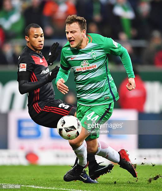 Philipp Bargfrede of Bremen is challenged by Marcel Tisserand of Ingolstadt during the Bundesliga match between Werder Bremen and FC Ingolstadt 04 at...