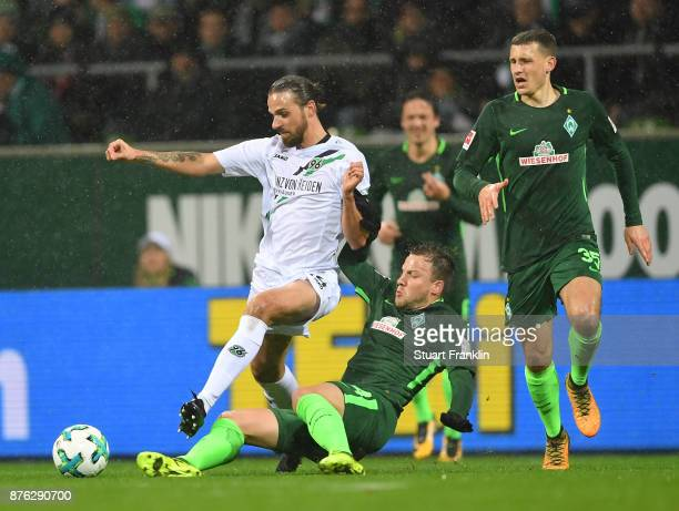 Philipp Bargfrede of Bremen is challenged by Martin Harnik of Hannover during the Bundesliga match between SV Werder Bremen and Hannover 96 at...