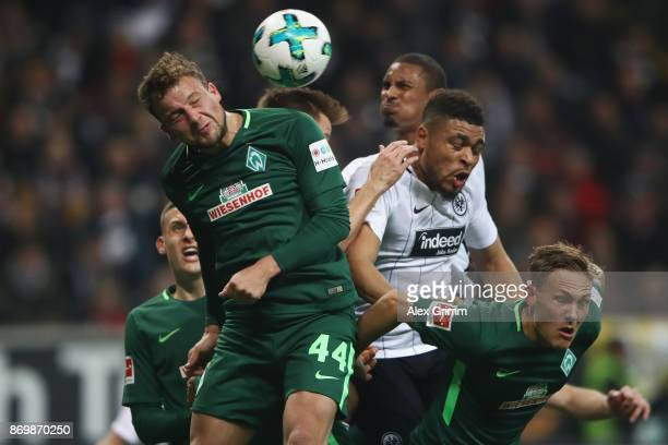 Philipp Bargfrede of Bremen jumps for a header with Simon Falette of Frankfurt during the Bundesliga match between Eintracht Frankfurt and SV Werder...