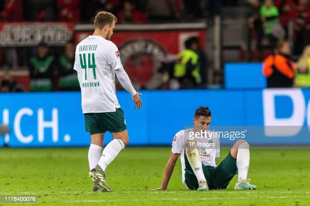 Philipp Bargfrede of SV Werder Bremen and Marco Friedl of SV Werder Bremen looks dejected during the Bundesliga match between Bayer 04 Leverkusen and...
