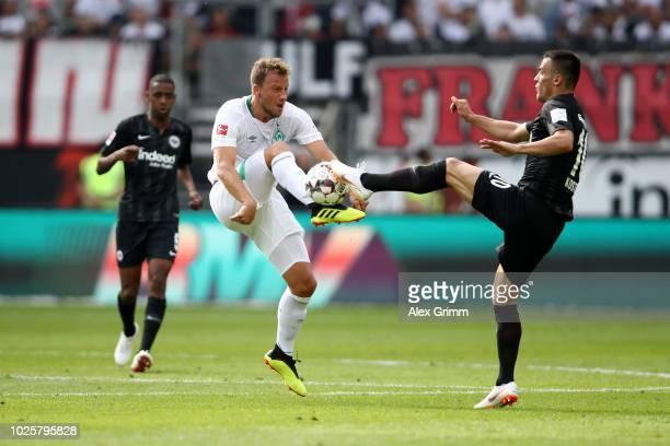 Philipp Bargfrede of WAerder Bremen battles for possession with Filip Kostic of Eintracht Frankfurt during the Bundesliga match between Eintracht...