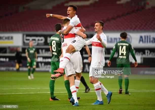 Philipp Foerster of VfB Stuttgart celebrates with team mates Sasa Kalajdzic and Roberto Massimo after scoring his team's first goal the Bundesliga...