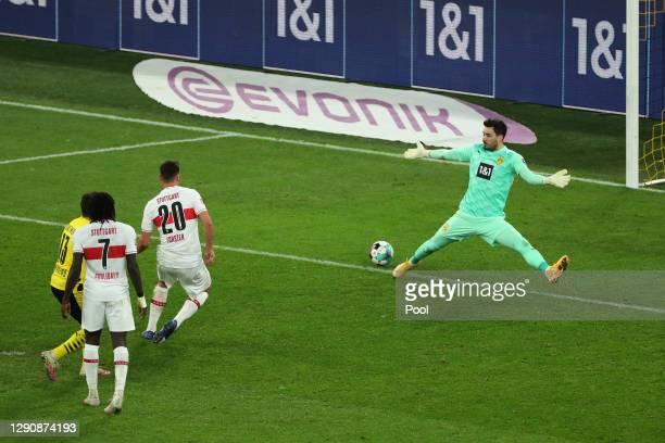 Philipp Foerster of VfB Stuttgart scores their team's third goal past Roman Buerki of Borussia Dortmund during the Bundesliga match between Borussia...