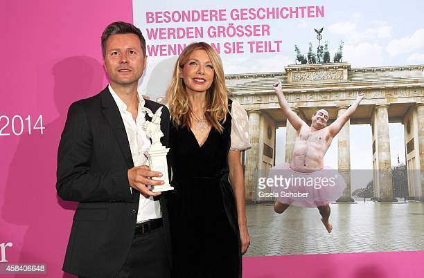 Philipp Friedel Telekom with award and Ursula Karven attend the CLOSER Magazin Hosts SMILE Award 2014 at Hotel Vier Jahreszeiten on November 4 2014...