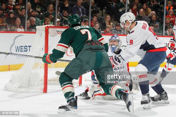 Philipp Grubauer and Dmitry Orlov of the Washington Capitals defend against Matt Cullen of the Minnesota Wild during the game at the Xcel Energy...